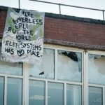 Protesters climb on roof of Oldham factory and graffiti police van – five people have been arrested