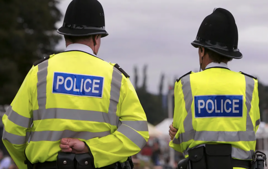 two police officers backs